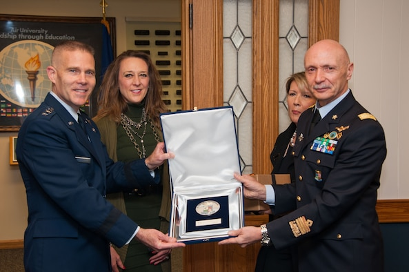 Lt. Gen. Steven Kwast, Commander and President of Air University, presents a plaque to Lt. Gen. Enzo Vecciarelli, Chief of Staff of the Italian Air Force, during the International Honor Roll Induction Ceremony on Maxwell Air Force Base, Ala., Feb. 10, 2017. The IHR program facilitates senior-leader military engagement with international partners and creates an environment of prestige for graduates of AU programs. (US Air Force photo by Bud Hancock)