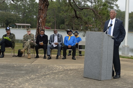 """Retired Marine, Maj. Gen. Cornell Wilson Jr., keynote speaker, addresses the attendees of the 2017 Black History Program at Marine Corps Logistics Base Albany's Boyette Park Amphitheater, here, Feb. 8. Speaking to the theme: """"Buffalo Soldiers, We Can, We Will! Ready Forward!,"""" Wilson, secretary, Department of Military and Veteran Affairs, State of North Carolina, recapped historical moments, honored members of the 9th and 10th Calvary Regiments and discussed their impact on African Americans in the military."""