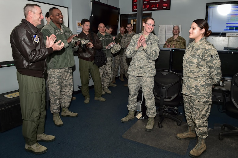 U.S. Air Force Gen. Terrence J. O'Shaughnessy, Pacific Air Forces commander, applauds an Airman after presenting her with a commander's coin at the Joint Mobility Complex on Joint Base Elmendorf-Richardson, Alaska, as he toured the base, Feb. 7, 2017. O'Shaughnessy toured various facilities throughout the installation to meet with Airmen and get a first-hand look at the broad spectrum of JBER mission sets.