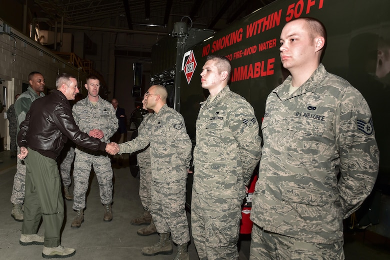 U.S. Air Force Gen. Terrence J. O'Shaughnessy, Pacific Air Forces commander, left, shakes hands with Airmen assigned to the 773rd Logistics Readiness Squadron at the Joint Readiness Complex on Joint Base Elmendorf-Richardson, Alaska, as he toured the base, Feb. 7, 2017. O'Shaughnessy toured various facilities throughout the installation to meet with Airmen and get a first-hand look at the broad spectrum of JBER mission sets.