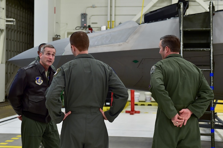 U.S. Air Force Gen. Terrence J. O'Shaughnessy, Pacific Air Forces commander, interacts with Airmen at the 525th Fighter Squadron in front of an F-22 Raptor on Joint Base Elmendorf- Richardson, Alaska, as he tours the base, Feb. 7, 2017. O'Shaughnessy also held an all-call to speak to Airmen about several topics including leadership philosophies, command priorities, and what Airmen can expect from him as well as what he expects from Airmen.
