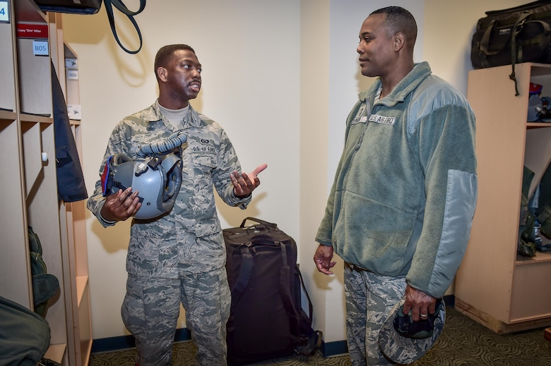 U.S. Air Force Staff Sgt. Richard Miller, assigned to the 3rd Operations Support Squadron, left, talks with Chief Master Sgt. Anthony Johnson, Pacific Air Forces (PACAF) command chief, at the 525th Fighter Squadron on Joint Base Elmendorf-Richardson, Alaska, as Johnson toured the base, Feb. 7, 2017. PACAF leadership toured various facilities throughout the installation to meet with Airmen and get a first-hand look at the broad spectrum of JBER mission sets.