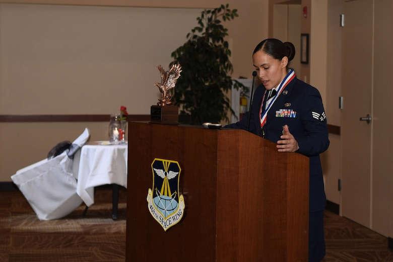 Senior Airman Crystal Velasquez, 460th Security Forces Squadron military working dog handler, presents a speech to her fellow Airman Leadership School classmates during their graduation Feb. 9, 2017, at the Leadership Develop Center on Buckley Air Force Base, Colo. Velasquez was presented with the prestigious John L. Levitow award, which is the highest award achievable in Professional Military Education. (U.S. Air Force photo by Airman Holden S. Faul/Released)