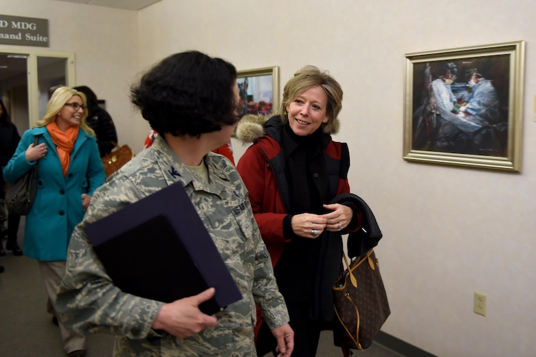 Donna O'Shaughnessy, spouse of U.S. Air Force Gen. Terrence O'Shaughnessy, Pacific Air Forces comander, walks with Col. Tambra Yates, 673rd Medical Group commander, after meeting with Exceptional Family Member Program families at the Joint Base Elmendorf-Richardson hospital, Feb. 7, 2017.
