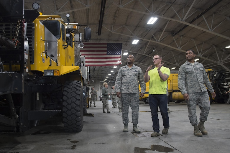 U.S. Air Force Chief Master Sgt. Anthony Johnson, left, Pacific Air Forces (PACAF) command chief, inspects snow removal vehicles belonging to the 773rd Civil Engineer Squadron while touring Joint Base Elmendorf-Richardson, Alaska, Feb. 7, 2017. PACAF leadership toured various facilities throughout the installation to meet with Airmen and get a first-hand look at the broad spectrum of JBER mission sets.