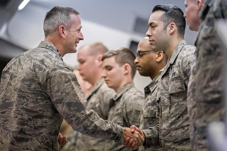 U.S. Air Force Gen. Terrence J. O'Shaughnessy, Pacific Air Forces commander, presents a commander's coin to outstanding Airmen during an all-call at Joint Base Elmendorf- Richardson, Alaska, Feb. 7, 2017. During the all-call, O'Shaughnessy spoke to Airmen about several topics including leadership philosophies, command priorities, and what Airmen can expect from him as well as what he expects from them.