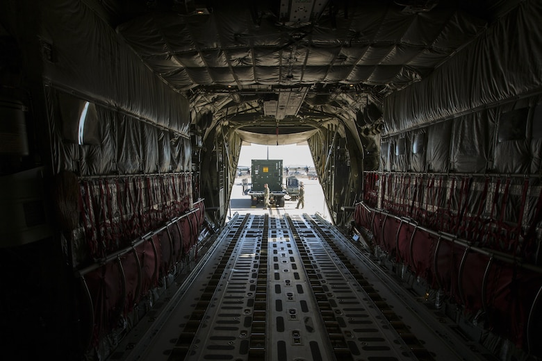 U.S. Marine Corps load masters with Marine Aerial Refueler Transport Squadron (VMGR) 352 load the 3d Marine Aircraft Wing Combat Camera Tactical Imagery Production System (TIPS) onto a KC-130 during Loading Exercise (LOADEX) 2015 aboard Marine Corps Air Station Miramar, San Diego, Calif., Nov. 20, 2015. The LOADEX provided the opportunity to develop 3d Marine Aircraft Wing Combat Camera Standard Operating Procedures to ensure TIPS air transport readiness. (U.S. Marine Corps photo by Lance Cpl. Nathaniel Castillo/Released)