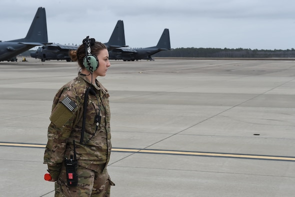 Senior Airman Nicole Pederson, a dedicated crew chief with the 1st Special Operations Aircraft Maintenance Squadron, awaits to marshal in an AC-130J Ghostrider gunship at Hurlburt Field, Fla., Jan. 10, 2017. Pederson was named the DCC for the newest AC-130J to arrive at Hurlburt Field. (U.S. Air Force photo by Senior Airman Jeff Parkinson)
