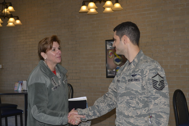 Gen. Lori Robinson, Commander, North American Aerospace Defense Command and United States Northern Command, greets Master Sgt. Samvel Korniyenko, 601st Air Operations Center, at an Airman's breakfast event here Feb 10. Throughout her Feb. 9-10 visit to the Continental U.S. North American Aerospace Defense Command Region-1st Air Force (Air Forces Northern) enterprise, Robinson talked with organization members about her priorities and expressed her deep appreciation for their professionalism and unwavering commitment to the CONR-1st AF (AFNORTH) mission. (Photo by Mary McHale)