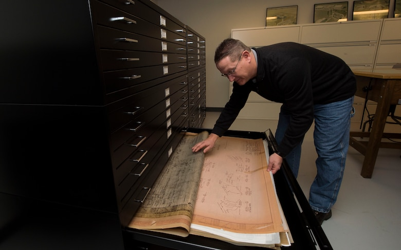 Matt Morris, Air Force Nuclear Weapons Center data manager, locates blueprints of missile field equipment at F.E. Warren Air Force Base, Wyo., Feb. 1, 2017. The document library has files from the intercontinental ballistic missile program's inception and are still accessed today to troubleshoot problems that can occur to the aging missile system. The Infrastructure and Equipment Division ensures that facility and infrastructure requirements are in place to support the ICBM weapons system across every missile complex. (U.S. Air Force photo by Staff Sgt. Christopher Ruano)