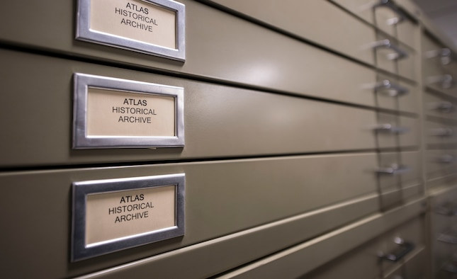 Record cabinets line the wall of the Air Force Nuclear Weapons Center infrastructure and equipment divisions building at F.E. Warren Air Force Base, Wyo., Feb. 1, 2017. In the building's library, historical files can be found on current and past missile systems to include the Atlas and Peacekeeper missiles. The Infrastructure and Equipment Division ensures that facility and infrastructure requirements are in place to support the intercontinental ballistic missile systems across every missile complex.  (U.S. Air Force photo by Staff Sgt. Christopher Ruano)