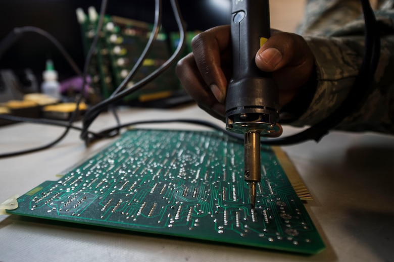Staff Sgt. Dorian Howard, Air Force Nuclear Weapons Center soldering technical advisor, repairs a Minuteman III power processer circuit board at F.E. Warren Air Force Base, Wyo., Feb. 1, 2017. The AFNWC electronic laboratory on F.E. Warren tests and repairs the circuit boards for all three intercontinental ballistic missile wings. The Infrastructure and Equipment Division ensures that facility and infrastructure requirements are in place to support the ICBM systems across every missile complex.  (U.S. Air Force photo by Staff Sgt. Christopher Ruano)