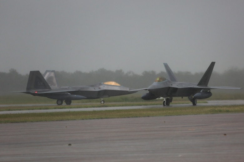 The first three of 12 U.S. Air Force F-22 Raptors arrive at Royal Australian Air Force Base Tindal, Feb. 10, 2017. The At the direction of Adm. Harry Harris Jr., U.S. Pacific Command commander, Pacific Air Forces sent the Raptors and approximately 190 Airmen from the 90th Fighter Squadron at Joint Base Elmendorf-Richardson, Alaska, to conduct combined exercises and training missions with the RAAF as part of the Enhanced Air Cooperation Initiative under the Force Posture Agreement between the United States and Australia.
