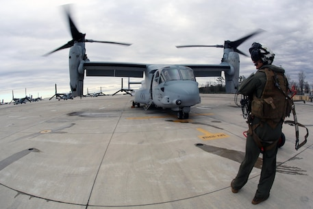 Sgt. Brett Hankins watches his surroundings as an MV-22 Osprey prepares for flight aboard Marine Corps Air Station New River, N.C., Feb. 9, 2017. The crew chief is in charge of being aware of their surrounds at all times to give the pilot proper direction when conducting flight operations. The pilots and crew chiefs rely on each other to complete their mission objectives. Hankins is a crew chief the Marine Medium Tiltrotor Squadron 263, Marine Aircraft Group 26, 2nd Marine Aircraft Wing. (U.S. Marine Corps photo by Cpl. Mackenzie Gibson/Released)