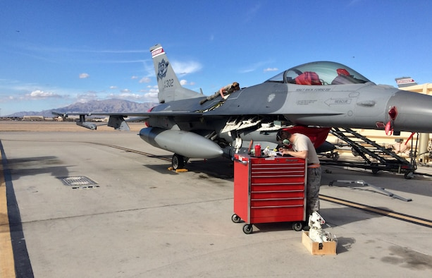 Crew chiefs with the 115th Fighter Wing perform routine inspections on an F-16 Fighting Falcon.
