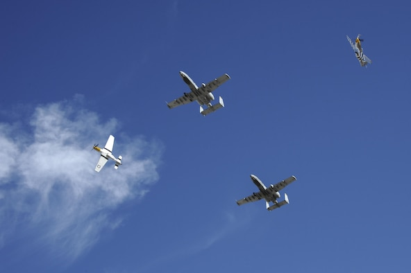 Two U.S. Air Force A-10C Thunderbolt IIs, a P-51 Mustang and a P-40 Warhawk fly in formation during the 2017 Heritage Flight Training and Certification Course at Davis-Monthan Air Force Base, Ariz., Feb. 10, 2017. The modern aircraft that participated in this year's HFTCC were the F-35 Lightning II, the F-22 Raptor, F-16 Fighting Falcon and the A-10C Thunderbolt II. (U.S. Air Force photo by Airman 1st Class Mya M. Crosby)