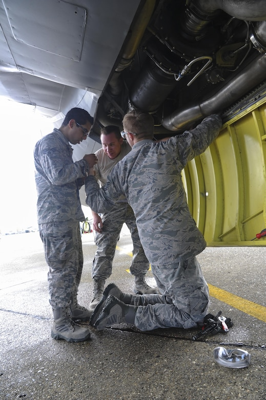 940th Aircraft Maintenance Squadron aircraft hydraulic technicians repair a hydraulic line on the KC-135 Stratotanker Feb. 10, 2017, at Beale Air Force Base, California. The Airmen practiced preparing four KC-135 Stratotankers for expedited takeoff. (U.S. Air Force photo by Senior Airman Tara R. Abrahams)