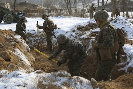 U.S. Marines with Alpha Company, 9th Engineer Support Battalion, 3rd Marine Logistics Group, and Republic of Korea Marines break and dig up dirt to create a trench during the exercise Korean Marine Exchange Program (KMEP) 17-8 on New Mexico Range, South Korea, January 28, 2017. KMEP is an annually scheduled training event designed to enhance to improve the tactical interoperability and camaraderie of the Republic of Korea (ROK) and U.S. Marines by allowing them to work side-by-side as a cohesive unit. The alliance between America and the Republic of Korea has grown even stronger based upon the shared interests and values of both nations. (U.S. Marine Corps photo by MCIPAC Combat Camera Lance Cpl. Tiana Boyd)