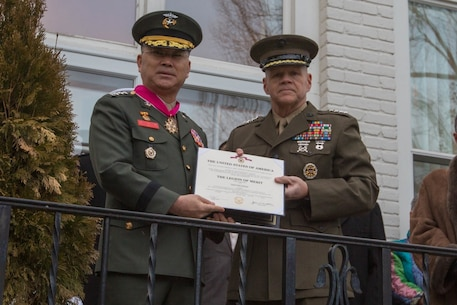 Commandant of the Marine Corps Gen. Robert B. Neller, right, and Lt. Gen. Lee Sang-Hoon, commandant of the Republic of Korea Marine Corps, pose for a photo during an honors ceremony at the Home of the Commandants, Washington, D.C., Feb. 9, 2017. Neller hosted Sang-Hoon for an honors ceremony and dinner. (U.S. Marine Corps photo by Cpl. Samantha K. Braun)