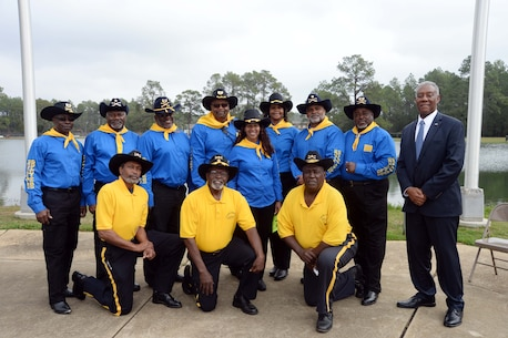 Members of the Buffalo Soldiers Motorcycle Clubs, Albany, Ga., and Thomasville, Ga., join keynote speaker, retired Marine, Maj. Gen. Cornell Wilson Jr. (right), secretary, Department of Military and Veteran Affairs, State of North Carolina, for the installation's 2017 Black History Program, Feb. 8. The event, held at Marine Corps Logistics Base Albany's Boyett Park Amphitheater, commemorated the 150-year legacy of the Buffalo Soldiers of the U.S. Calvary's 9th and 10th Regiments.