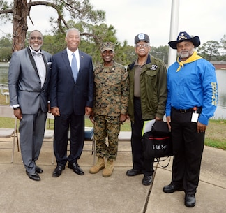 Program participants for the installation's 2017 Black History Program, join keynote speaker, retired Marine, Maj. Gen. Cornell Wilson Jr. (second from left), secretary, Department of Military and Veteran Affairs, State of North Carolina, at Marine Corps Logistics Base Albany's Boyett Park Amphitheater, Feb. 8. The event commemorated the 150-year legacy of the Buffalo Soldiers of the U.S. Calvary's 9th and 10th Regiments.