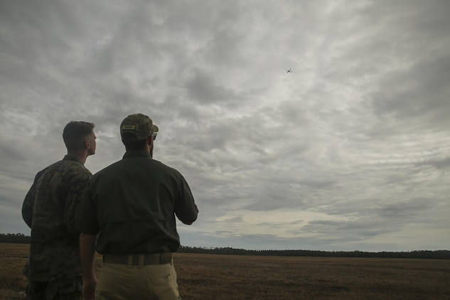 Shaun Sorensen, right, a small unmanned aerial systems instructor with Training and Logistics Support Activity, and a Marine with Task Force Southwest, left, fly the Instant Eye SUAS at Camp Lejeune, N.C., Feb. 8, 2017. The Instant Eye is revolutionary in that it can fly easily into buildings, over walls and hills, and can take off and land vertically. Approximately 300 Marines are assigned to Task Force Southwest, whose mission will be to train, advise and assist the Afghan National Army 215th Corps and 505th Zone National Police. (U.S. Marine Corps photo by Sgt. Lucas Hopkins)
