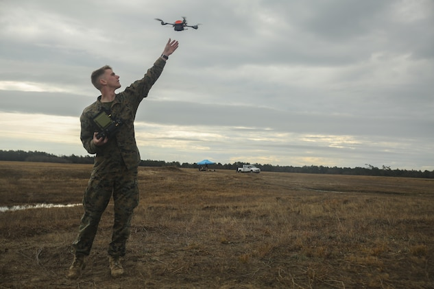 A Marine with Task Force Southwest catches the Instant Eye small unmanned aerial system following a flight at Camp Lejeune, N.C., Feb. 8, 2017. The drone allows operators to record surveillance and execute reconnaissance in small, confined areas which are otherwise inoperable with larger aircraft. Approximately 300 Marines are assigned to Task Force Southwest, whose mission will be to train, advise and assist the Afghan National Army 215th Corps and 505th Zone National Police. (U.S. Marine Corps photo by Sgt. Lucas Hopkins)