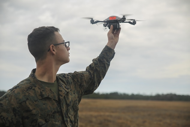 A Marine with Task Force Southwest prepares to launch the Instant Eye small unmanned aerial system at Camp Lejeune, N.C., Feb. 8, 2017. Due to its compact size, the Instant Eye will allow Marines to capture imagery and conduct reconnaissance in buildings and other confined areas. Task Force Southwest is comprised of approximately 300 Marines, whose mission will be to train, advise and assist the Afghan National Army 215th Corps and 505th Zone National Police. (U.S. Marine Corps photo by Sgt. Lucas Hopkins)