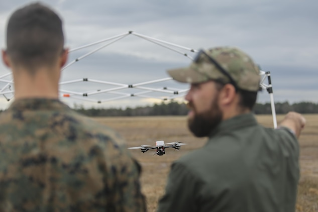 Shaun Sorensen, right, a small unmanned aerial systems instructor with Training and Logistics Support Activity, instructs a Marine with Task Force Southwest, left, on flying maneuvers of the Instant Eye SUAS at Camp Lejeune, N.C., Feb. 8, 2017. The Instant Eye is revolutionary in that it can fly easily into buildings, over walls and hills, and can take off and land vertically. Approximately 300 Marines are assigned to Task Force Southwest, whose mission will be to train, advise and assist the Afghan National Army 215th Corps and 505th Zone National Police. (U.S. Marine Corps photo by Sgt. Lucas Hopkins)