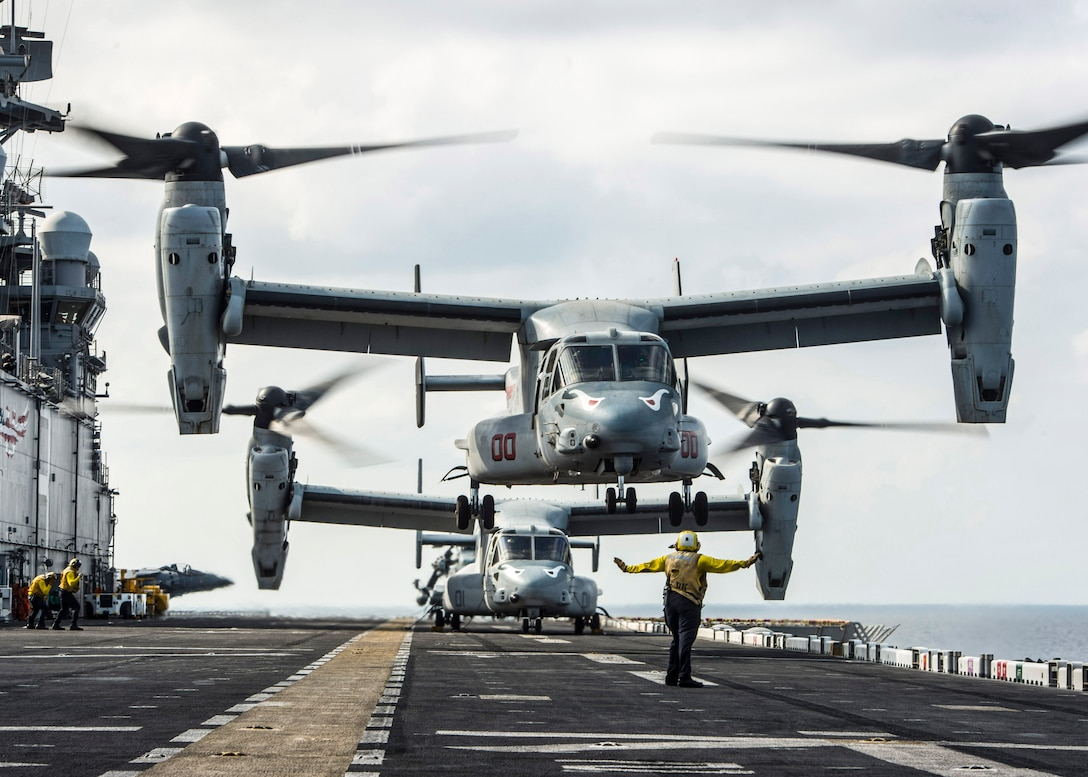 GULF OF ADEN (Feb. 12, 2017) Aviation Boatswain's Mate (Handling) 3rd Class Jalisa Hill, from Spring, Texas, signals for an MV-22B Osprey, assigned to Marine Medium Tiltrotor Squadron (VMM) 163 (Reinforced), to land on the flight deck of the amphibious assault ship USS Makin Island (LHD 8). Makin Island is deployed in the U.S. 5th Fleet area of operations in support of maritime security operations designed to reassure allies and partners, and preserve the freedom of navigation and the free flow of commerce in the region. (U.S. Navy photo by Mass Communication Specialist 3rd Class Devin M. Langer)