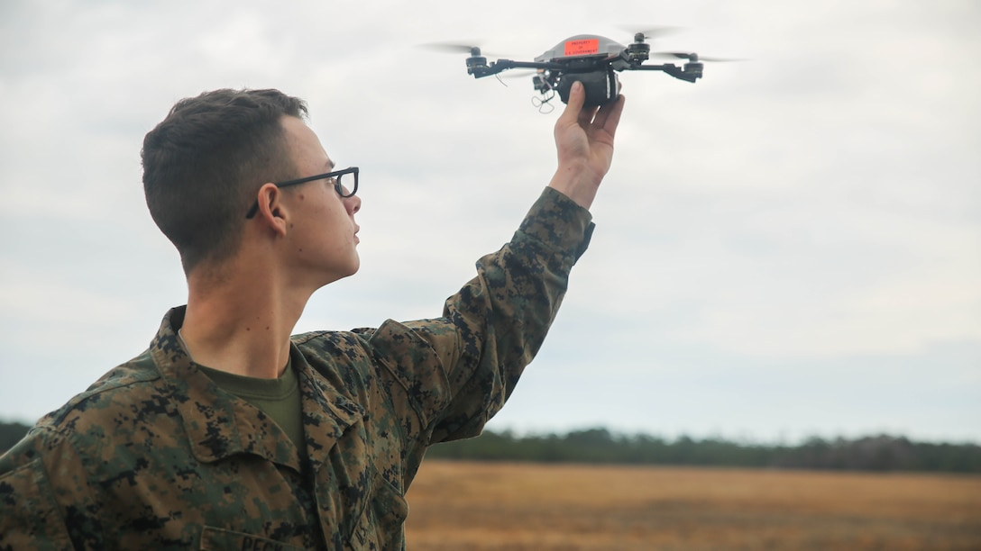 A Marine with Task Force Southwest prepares to launch the Instant Eye small unmanned aerial system at Marine Corps Base Camp Lejeune, North Carolina, Feb. 8, 2017. Due to its compact size, the Instant Eye will allow Marines to capture imagery and conduct reconnaissance in buildings and other confined areas. Task Force Southwest is comprised of approximately 300 Marines, whose mission will be to train, advise and assist the Afghan National Army 215th Corps and 505th Zone National Police.