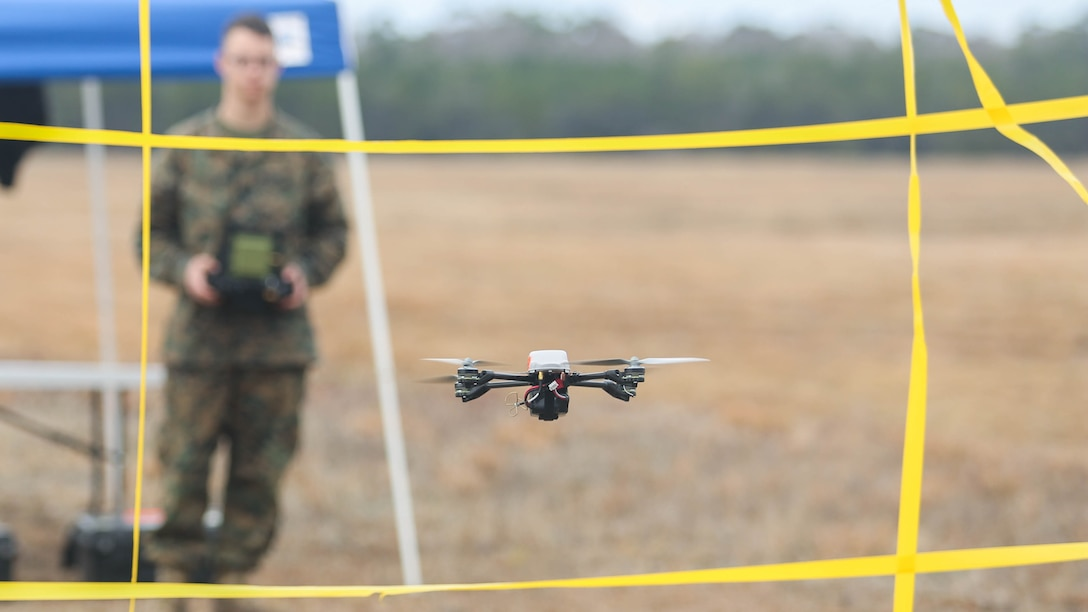 A Marine with Task Force Southwest flies the Instant Eye small unmanned aerial system through an obstacle at Marine Corps Base Camp Lejeune, North Carolina, Feb. 8, 2017. Unlike larger drones, the Instant Eye can maneuver in tightly confined spaces, such as buildings and around corners, to record surveillance and conduct reconnaissance. Task Force Southwest is comprised of approximately 300 Marines, whose mission will be to train, advise and assist the Afghan National Army 215th Corps and 505th Zone National Police.