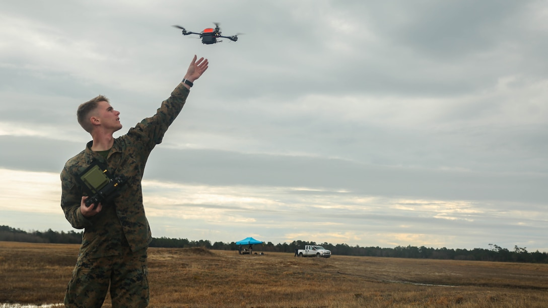 A Marine with Task Force Southwest catches the Instant Eye small unmanned aerial system following a flight at Marine Corps Base Camp Lejeune, North Carolina, Feb. 8, 2017. The drone allows operators to record surveillance and execute reconnaissance in small, confined areas which are otherwise inoperable with larger aircraft. Approximately 300 Marines are assigned to Task Force Southwest, whose mission will be to train, advise and assist the Afghan National Army 215th Corps and 505th Zone National Police.