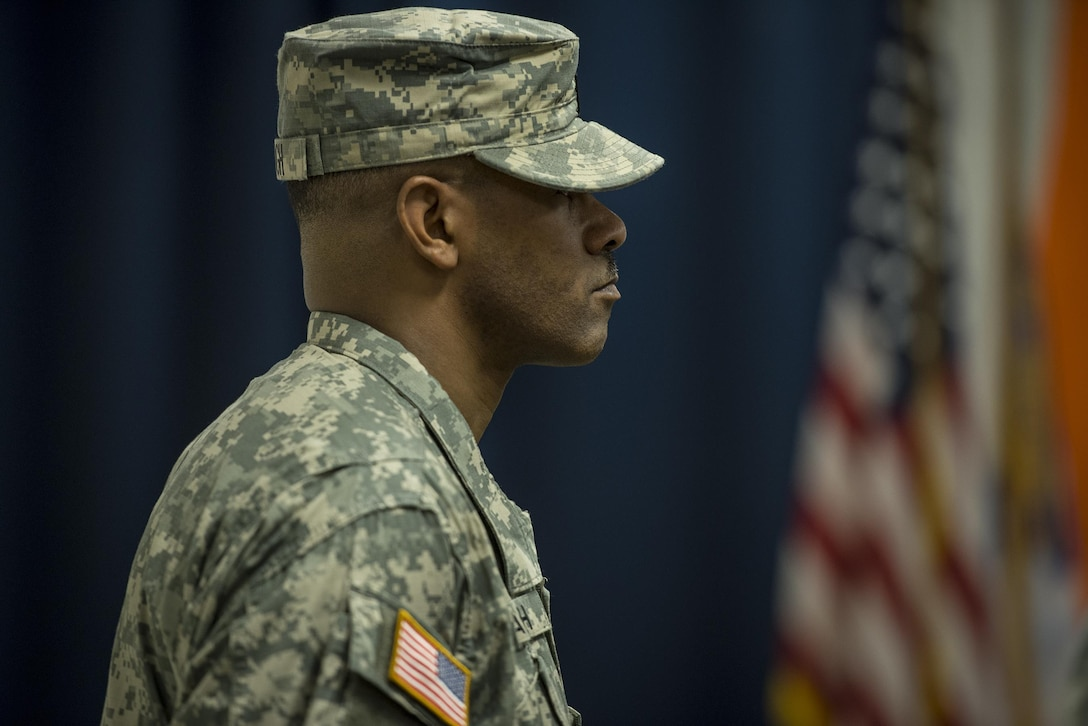 U.S. Army Reserve 1st Sgt. Warren Waugh, of Detachment 6, 335th Signal Command (Theater), stands in formation at the position of attention during a deployment ceremony at the command headquarters in East Point, Ga., Feb. 12, 2017.
