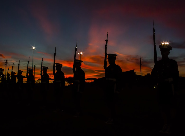 "The U.S. Marine Corps Silent Drill Platoon practices ""long line,"" a portion of their drill routine, during a month-long training phase as a part of the Marine Corps Battle Color Detachment aboard Marine Corps Air Station Yuma, Az., Feb. 8, 2017. The BCD is comprised of the U.S. Marine Corps Silent Drill Platoon, ""The Commandant's Own,"" the U.S. Marine Drum & Bugle Corps and the U.S. Marine Corps Color Guard. This highly skilled unit travels across the country to demonstrate the discipline, professionalism, and ""Esprit de Corps"" of United States Marines. (Official Marine Corps photo by Cpl. Robert Knapp/Released)"