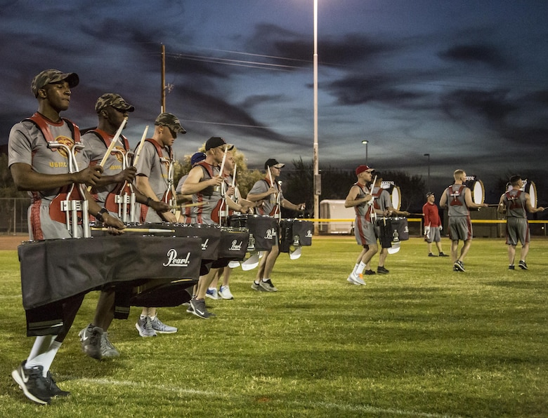 "The U.S. Marine Drum & Bugle Corps practices music in motion during a portion of their month-long training phase as a part of the Marine Corps Battle Color Detachment aboard Marine Corps Air Station Yuma, Az., Feb. 8, 2017. The BCD is comprised of the U.S. Marine Corps Silent Drill Platoon, ""The Commandant's Own,"" the U.S. Marine Drum & Bugle Corps and the U.S. Marine Corps Color Guard. This highly skilled unit travels across the country to demonstrate the discipline, professionalism, and ""Esprit de Corps"" of United States Marines. (Official Marine Corps photo by Cpl. Robert Knapp/Released)"