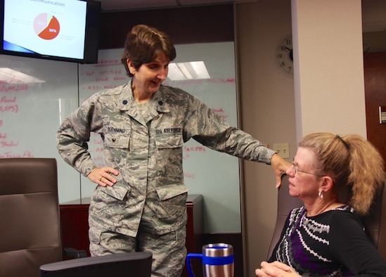 """932nd Airlift Wing Process Manager and Certified Covey facilitator, Lt. Col. Stephanie Boehning, talks with Deb Teague from the 932nd Family Readiness Office, during Boehning's Thursday morning class about how communication should work in the workplace, but is sometimes misunderstood. Col. Boehning's courses are all listed on the wing's EIM page and email reminders are sent to the unit members each week to give them a chance to come participate, and not only improve themselves personally, but also improve the execution of their unit, squadron, group and wing mission. """"Instead of offering four-hour lecture courses, I'm trying something much different and much shorter. I'll be offering two opportunities each week,"""" said Colonel Boehning. """"SOS Tuesdays: Each Tuesday you will receive an SOS email. In this instance, SOS stands for """"Sharpen our Saw"""" which means stop and take time for you. If you keep sawing without stopping, then eventually the blade will be dull and not cut as well,"""" she said.   """"The same goes for you. If you keep working and working without stopping to re-energize, you'll be far less productive. The idea is to stop, read the email, and take some time for you,"""" Col Boehning said. The plan is for it to take less than 15-minutes for anyone to read, learn, and apply. Reminders on upcoming classes at the 932nd Airlift Wing: Take Time Thursdays is another opportunity to """"sharpen your saw"""" by physically coming to class each Thursday from 10:15 a.m., to 10:45 a.m. The training session is usually held in the 932 AW Auditorium or conference room. """"Topics will vary and we'll have many guest speakers as we bring in experts to cover various topics,"""" said Boehning. (U.S. Air Force photo by Lt. Col. Stan Paregien)"""