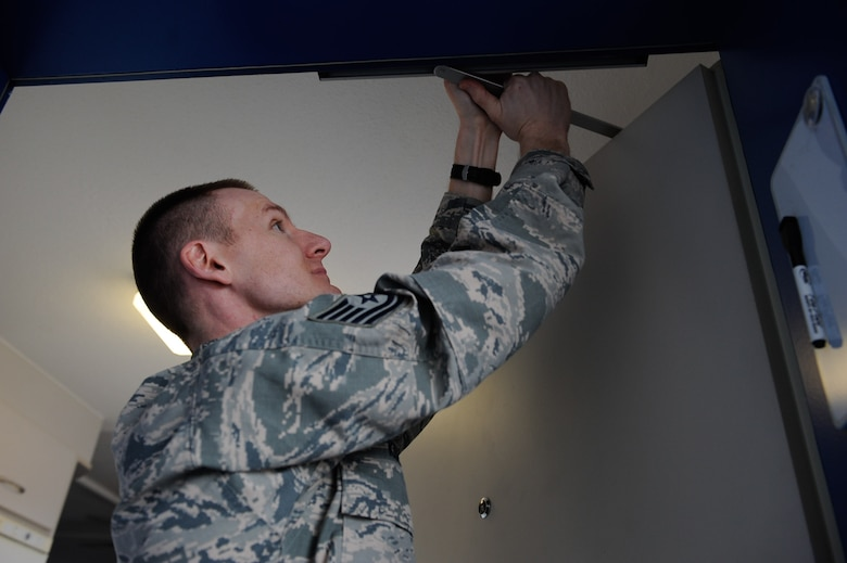 Tech. Sgt. Gentry Koepp, 86th Civil Engineering Squadron unaccompanied housing NCO in charge, inspects a dormitory door on Ramstein Air Base, Germany, Feb. 7, 2017. The Dorm Reception Center is responsible for more than 1,500 dorms on both Ramstein Air Base and Kapaun Air Station. (U.S. Air Force photo by Airman 1st Class Savannah L. Waters)