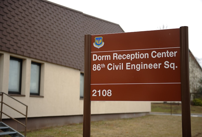The Dorm Reception Center sign is displayed on Ramstein Air Base, Germany, Feb. 7, 2017. Ramstein's Dorm Reception Center and the Vogelweh Housing Office are dedicated to ensuring that Airmen who are moving from the dorms experience a smooth transition. (U.S. Air Force photo by Airman 1st Class Savannah L. Waters)