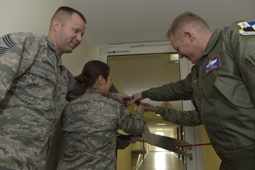 Col. Joe McFall, right, 52nd Fighter Wing commander, Chief Master Sgt. Edwin Lugwigsen, left, 52nd FW command chief, and Capt. Tawnie Gulizia, center, 52nd FW Staff Judge Advocate, cuts the ribbon to officially open the tax center at Spangdahlem Air Base, Germany, Feb. 13, 2017. The tax center offers a free service to assist individuals with basic federal and state income tax returns for E-5 and below. (U.S. Air Force photo by Staff Sgt. Jonathan Snyder)