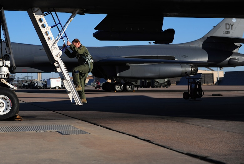 Maj. Gen. Richard Scobee, 10th Air Force commander, climbs a ladder to board a B-1B Lancer at Dyess Air Force Base, Texas, Feb. 11, 2017. This is a B-1B Lancer familiarization flight, which exposes rated aviators to the B-1 mission. (U.S. Air Force photo by Airman 1st Class April Lancto)