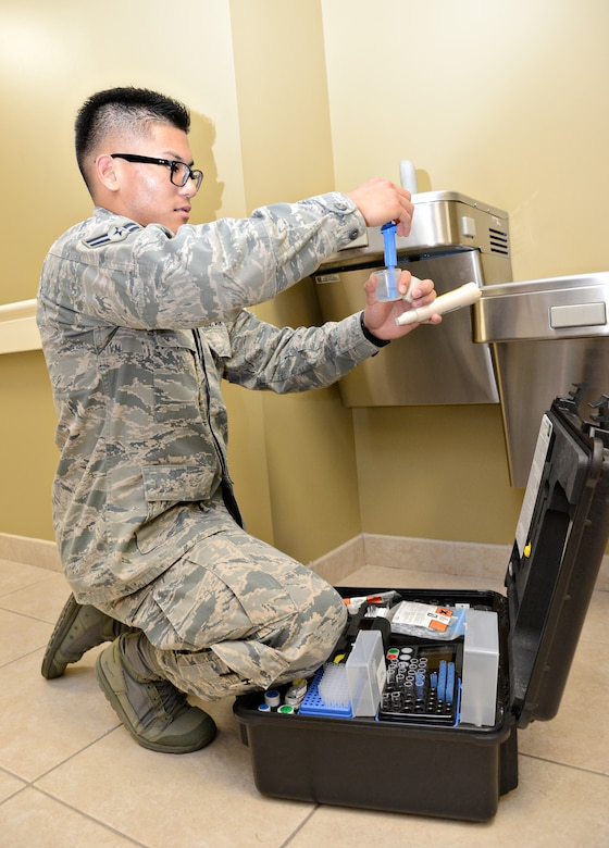 Airman 1st Class Leylan Umblas, a bioenvironmental engineering technician with the 72nd Aerospace Medicine Squadron, uses a portable mini lab to test for pH levels, chlorine, fluoride, lead copper or any bacteriological agent in water sources across Tinker. (Air Force photo by Kelly White)