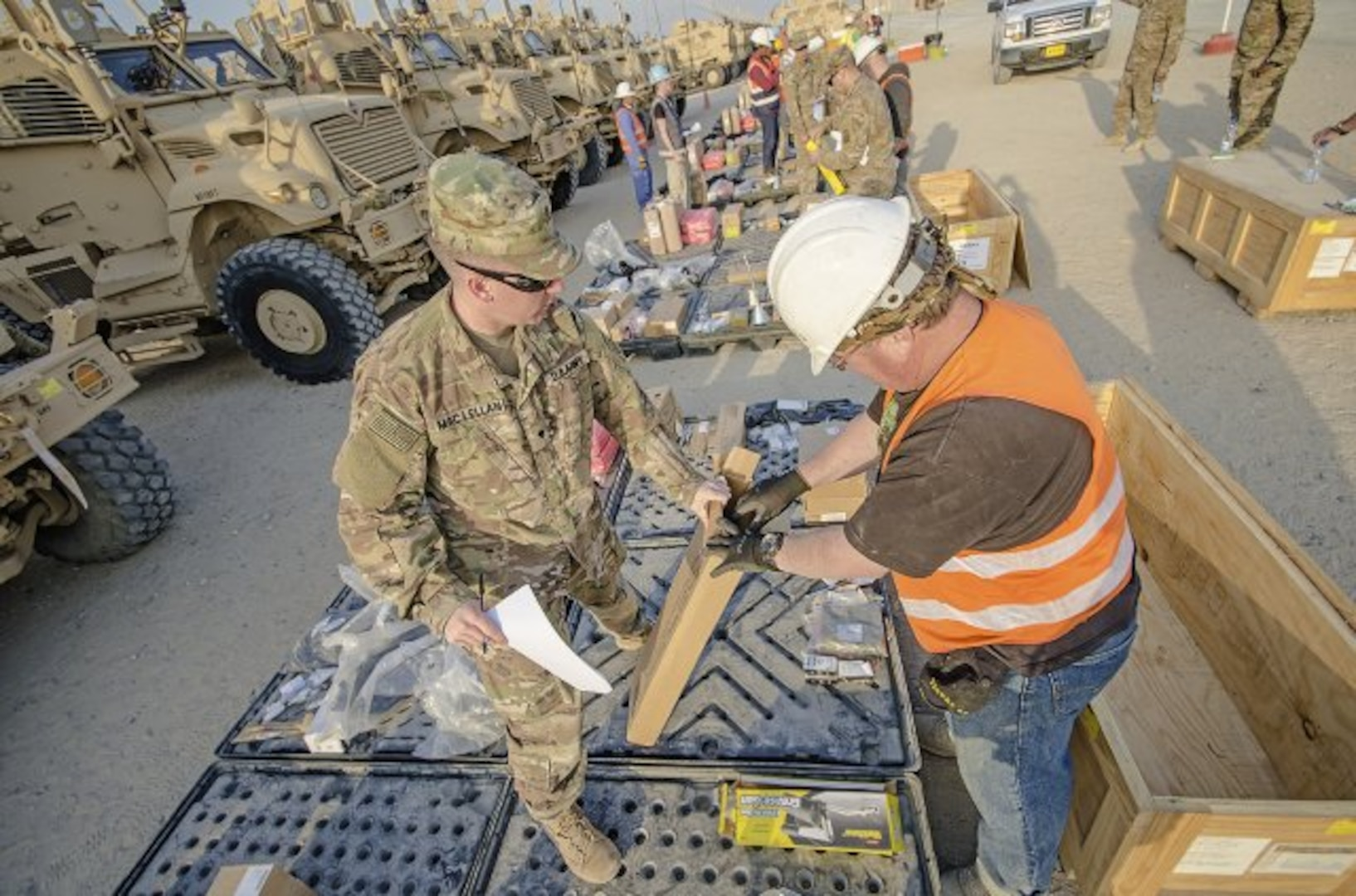 Soldiers with the 2nd Brigade Combat Team, 82nd Airborne Division verify inventory during an equipment layout led by the 401st Army Field Support Brigade at Camp Arifjan, Kuwait, Feb. 6. (U.S. Army photo by Justin Graff, 401st AFSB Public Affairs)