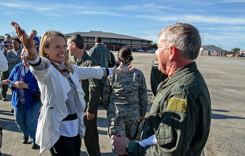 "Former 317th Airlift Squadron member, retired Lt. Col. Debi Rieflin congratulates retiring Lt. Col. Rick Davis, 317th AS, after Davis' ""fini flight"" in a Joint Base CHarleston C-17 Feb. 10. (U.S.Air Force photo by Michael Dukes)"