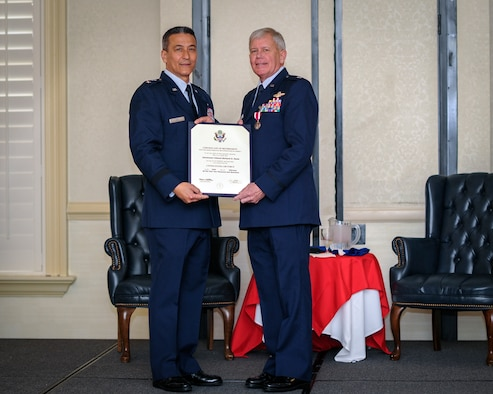 (From left) Former 315th Airlift Wing Vice Commander, Maj. Gen. Michael Kim, mobilization assistant to the Air Force Reserve Command commander, officiated over Lt. Col. Rick Davis', 317 Airlift Squadron, with a retirement certificate during his retirement ceremony at Joint Base Charleston, S.C Feb. 12. (U.S. Air Force photo by Senior Airman Tom Brading)