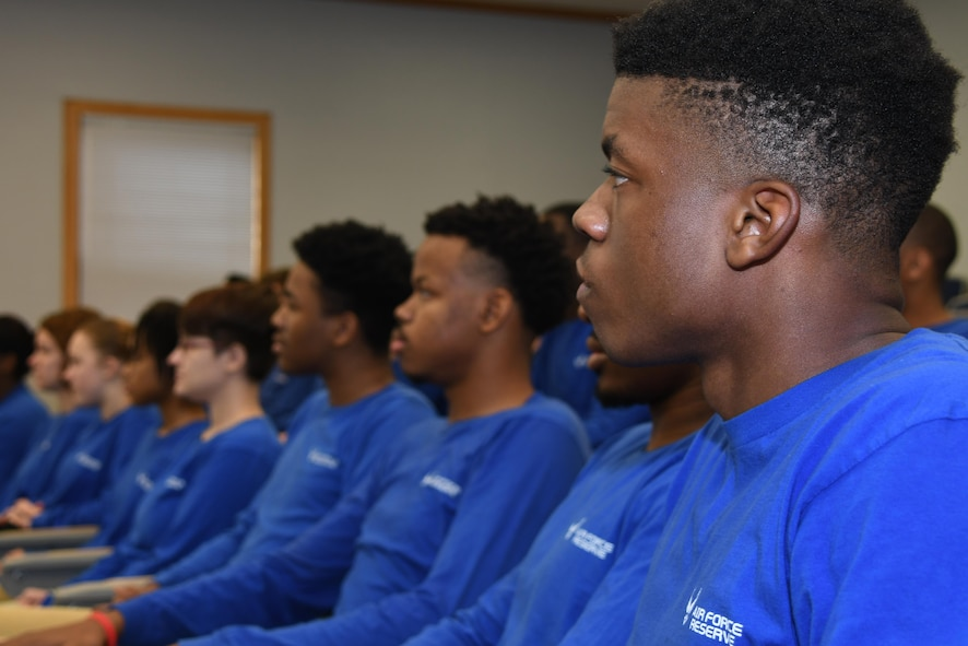 U.S. Air Force trainees from the 307th Developmental Training Flight pay close attention to Master Sgt.  Carlos Recorder, 433rd Training Squadron military training instructor, during a speech at Barksdale Air Force Base, La., Feb. 11, 2017.  The 307th DTF is designed to help trainees who have enlisted and are waiting to go to basic military training.  Recorder was on hand to tell the trainees how to best prepare physically and mentally for the challenges of BMT.  (U.S. Air Force photo by Tech. Sgt. Ted Daigle/Released)