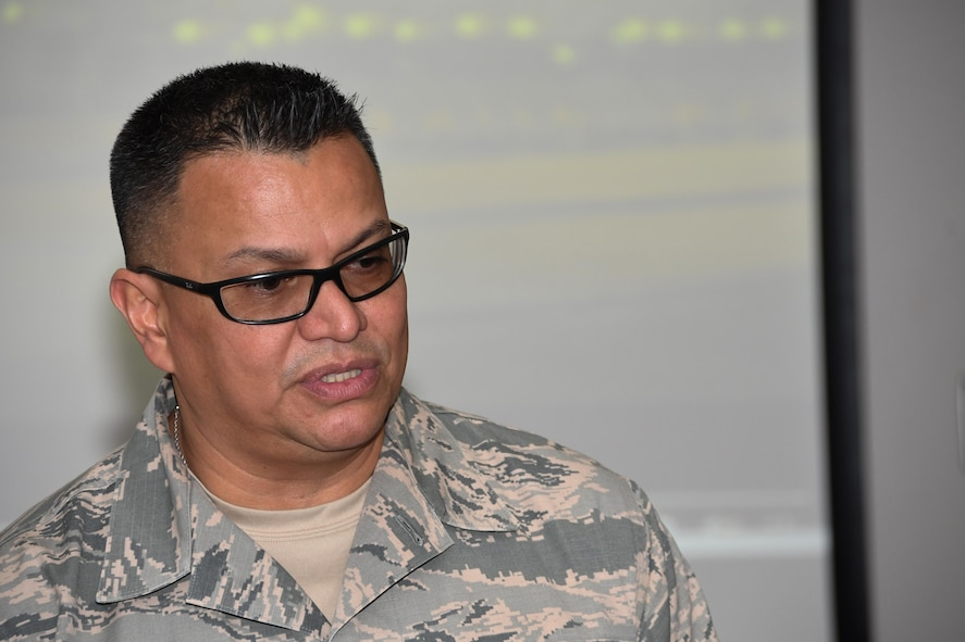 U.S. Air Force Master Sgt. Carlos Recorder, 433rd Training Squadron military training instructor, speaks to a group of Airmen from the 307th Bomb Wing during a recruiting session at Barksdale Air Force Base, La., Feb. 11, 2017.  Recorder spoke of the need for qualified Airmen to train the Air Force of tomorrow and all the benefits, tangible and intangible, that come with the job.  Airmen were able to get their questions answered about becoming a MTI and meet individually with Recorder after the session. (U.S. Air Force photo by Tech. Sgt. Ted Daigle/Released)