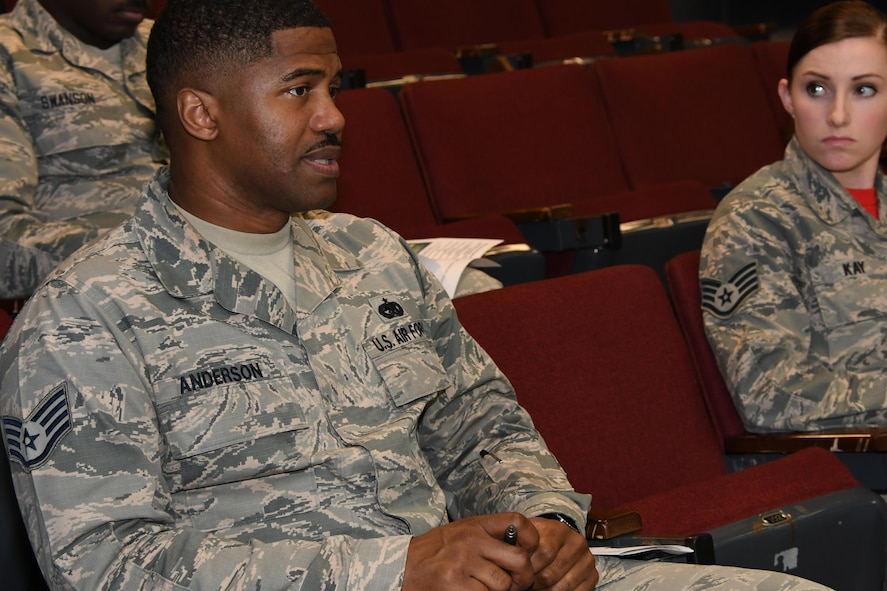 U.S. Air Force Staff Sgt. Davon Anderson, 307th Logistical Readiness Squadron fuels journeyman, asks a question during a session to recruit military training instructors at Barksdale Air Force Base, La., Feb. 11, 2017.  The question and answer session was part of a presentation by Master Sgt. Carlos Recorder, 433rd Training Squadron military training instructor.  The 433rd TRS is in need of more than 30 instructors to train Air Force recruits during basic military training.  (U.S. Air Force photo by Tech. Sgt. Ted Daigle/Released)