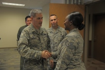 Brig. Gen. Lenny Richoux, 18th Air Force vice commander, presents a coin to Staff Sgt. Paquita Williams, 91st Air Refueling Squadron Aviation Resource Management NCO in charge, at MacDill Air Force Base, Florida, Feb. 2, 2017. Richoux met with many star performers around MacDill during his visit of the base and spoke at the 6th Air Mobility Wing's annual-awards ceremony the following night. (U.S. Air Force photo by Airman 1st Class Adam R. Shanks)