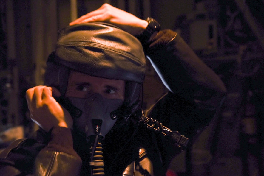 U.S. Air Force Staff Sgt. Jonathan Stager, 29th Weapons Squadron instructor loadmaster, checks his oxygen mask and communication system during pre-flight procedures Feb. 3, 2017, at Little Rock Air Force Base, Ark. Inspecting an oxygen mask ensures that in the event of an emergency, oxygen is readily available. (U.S. Air Force photo by Senior Airman Stephanie Serrano)